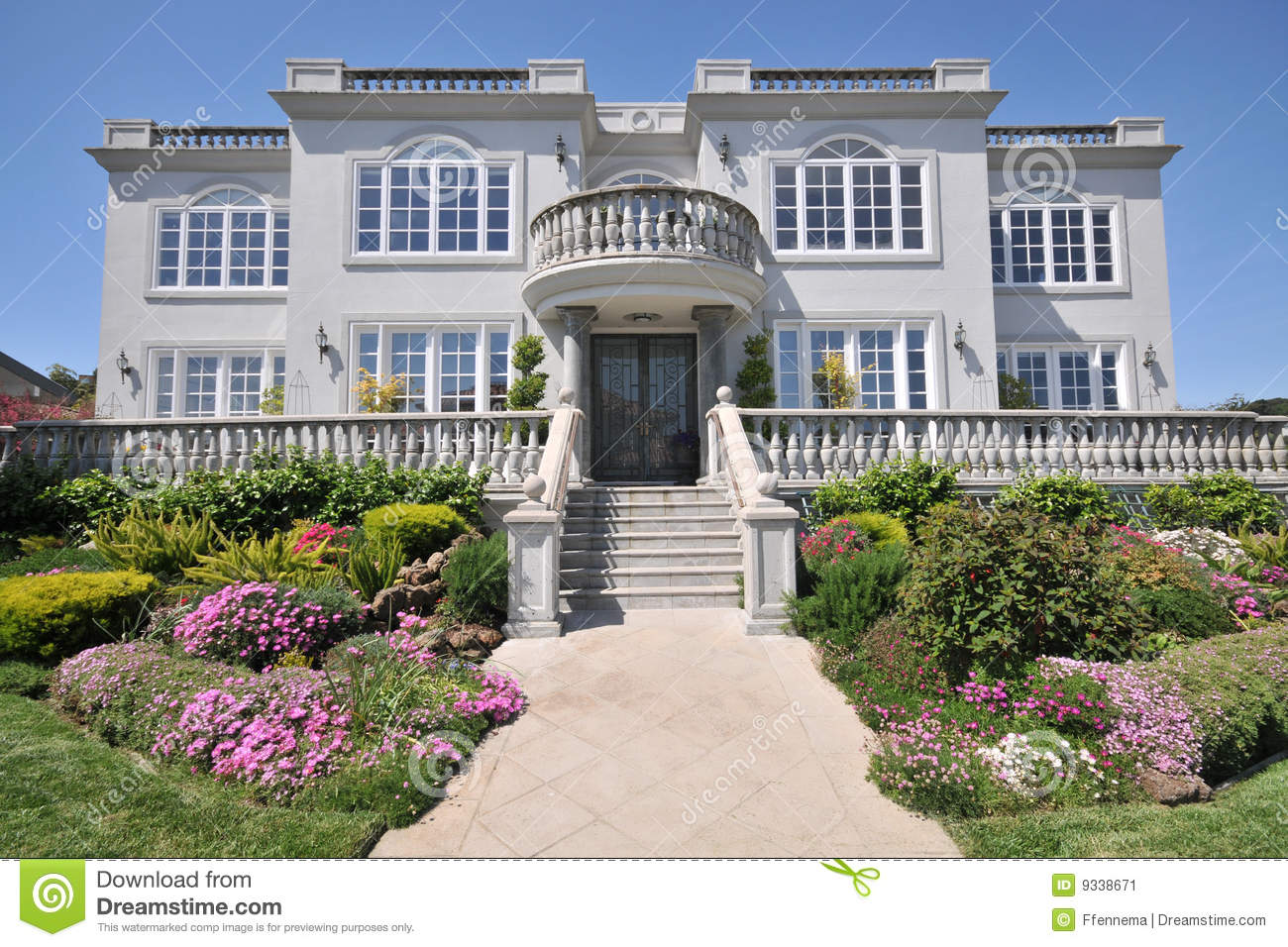 Majestic Two Story Mansion With Shrubs In Yard Stock Image
