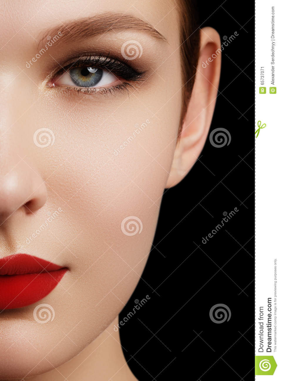 Make-up and cosmetics. Beauty woman face isolated on black background. Beautiful model girl makeup. Gorgeous lady with blue eyes
