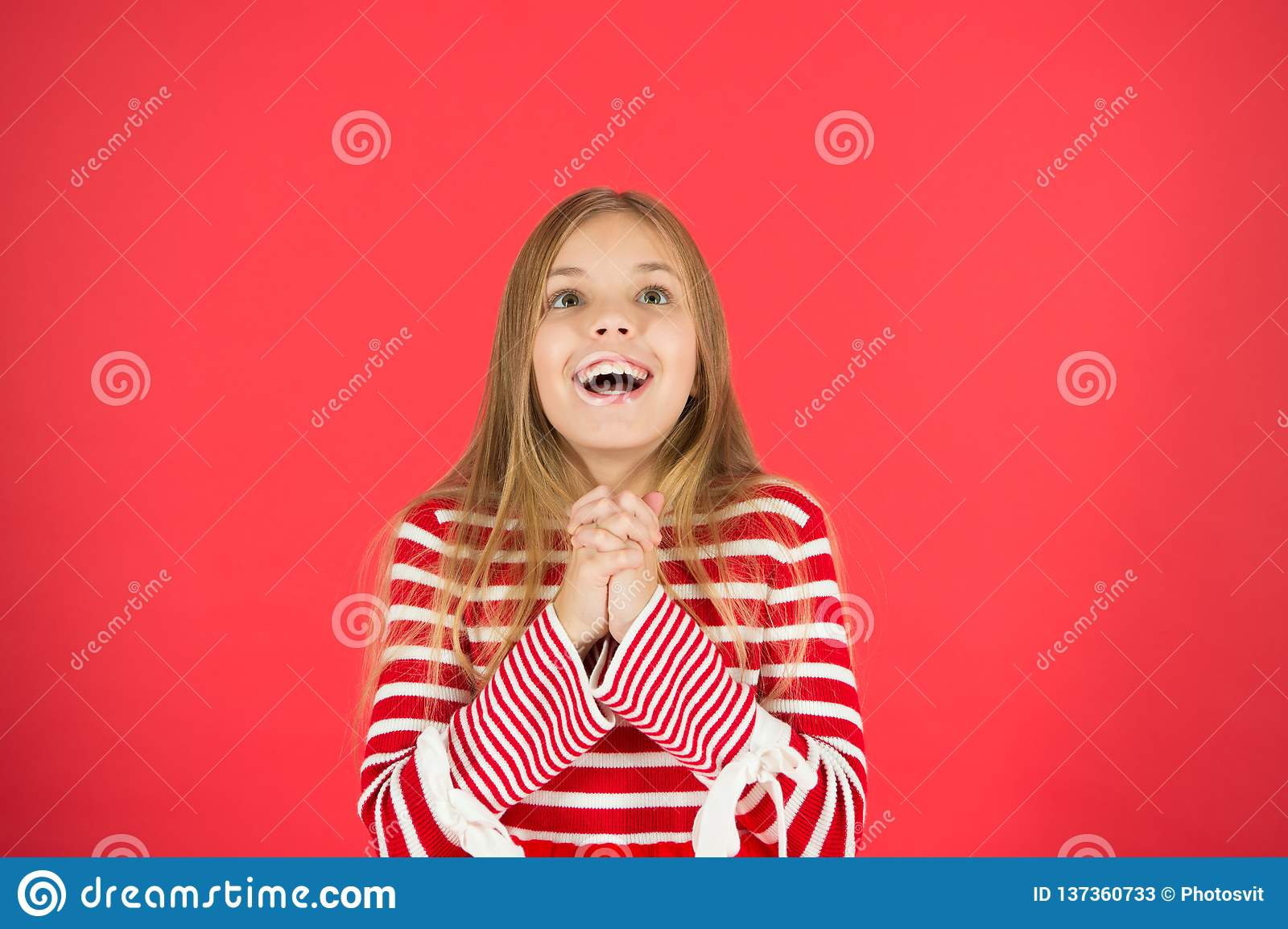 Make a wish. Hope for the best. Girl hopeful excited face making wish. Believe in miracle. Child girl dreaming her wish