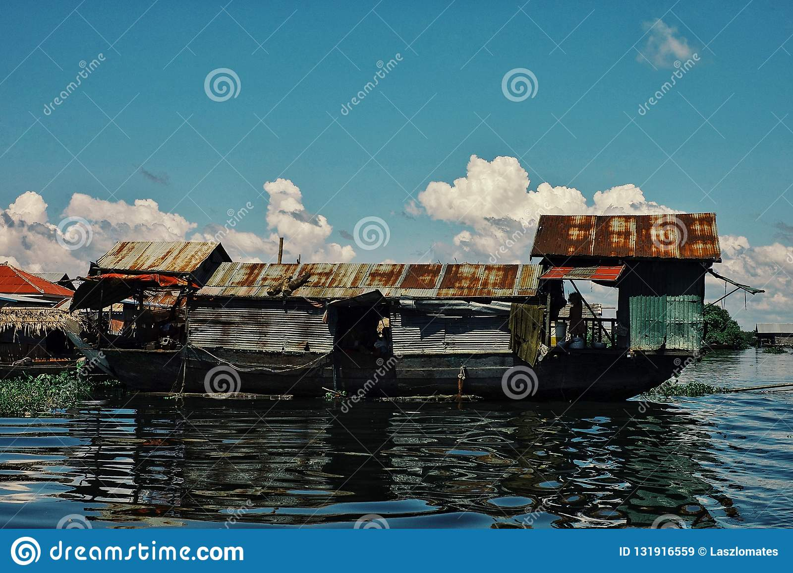 makeshift floating boat like house building in the middle of the flooded lake
