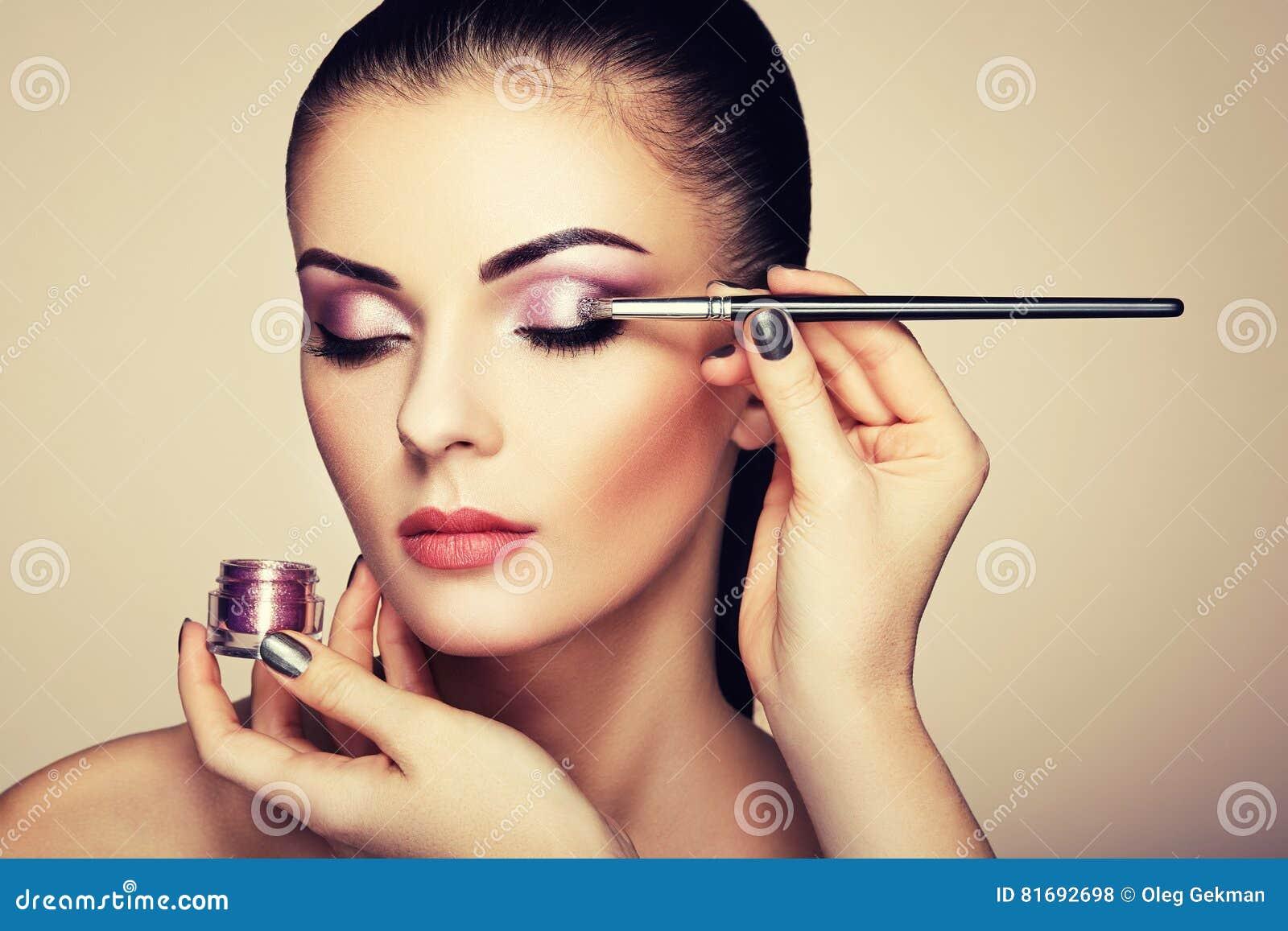 Makeup Artist Applies Eye Shadow Stock Photo - Image of