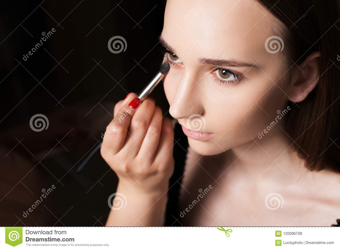 Makeup Artist Applying A Concealer On Model Stock Photo Image Of Face