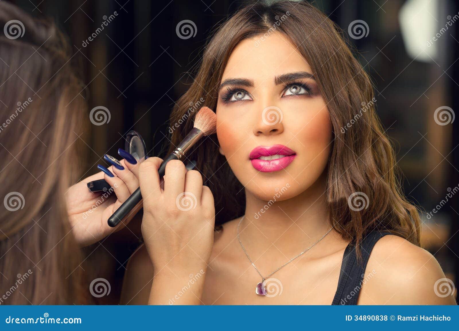 Makeup Artist Applying Make Up On Beautiful Model Royalty ...