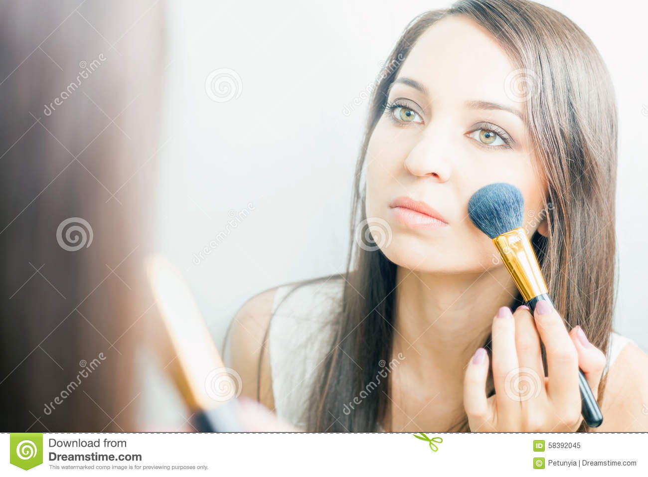 Makeup artist woman doing make up using cosmetic brush for yourself download makeup artist woman doing make up using cosmetic brush for yourself stock image solutioingenieria Image collections
