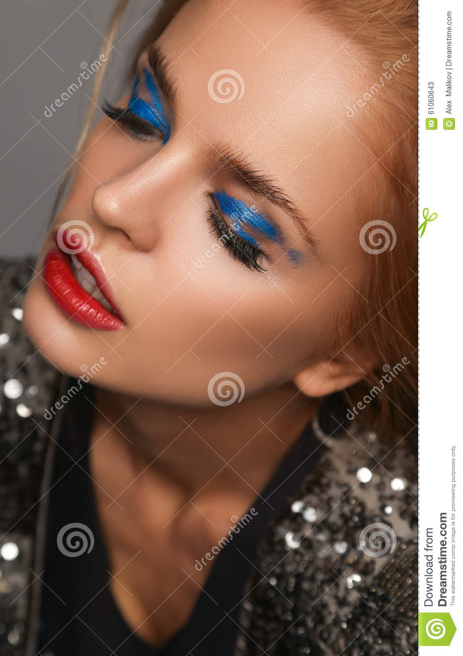 Makeup And Beauty Theme: Beautiful Girl With Red Lips And Blue Eyes