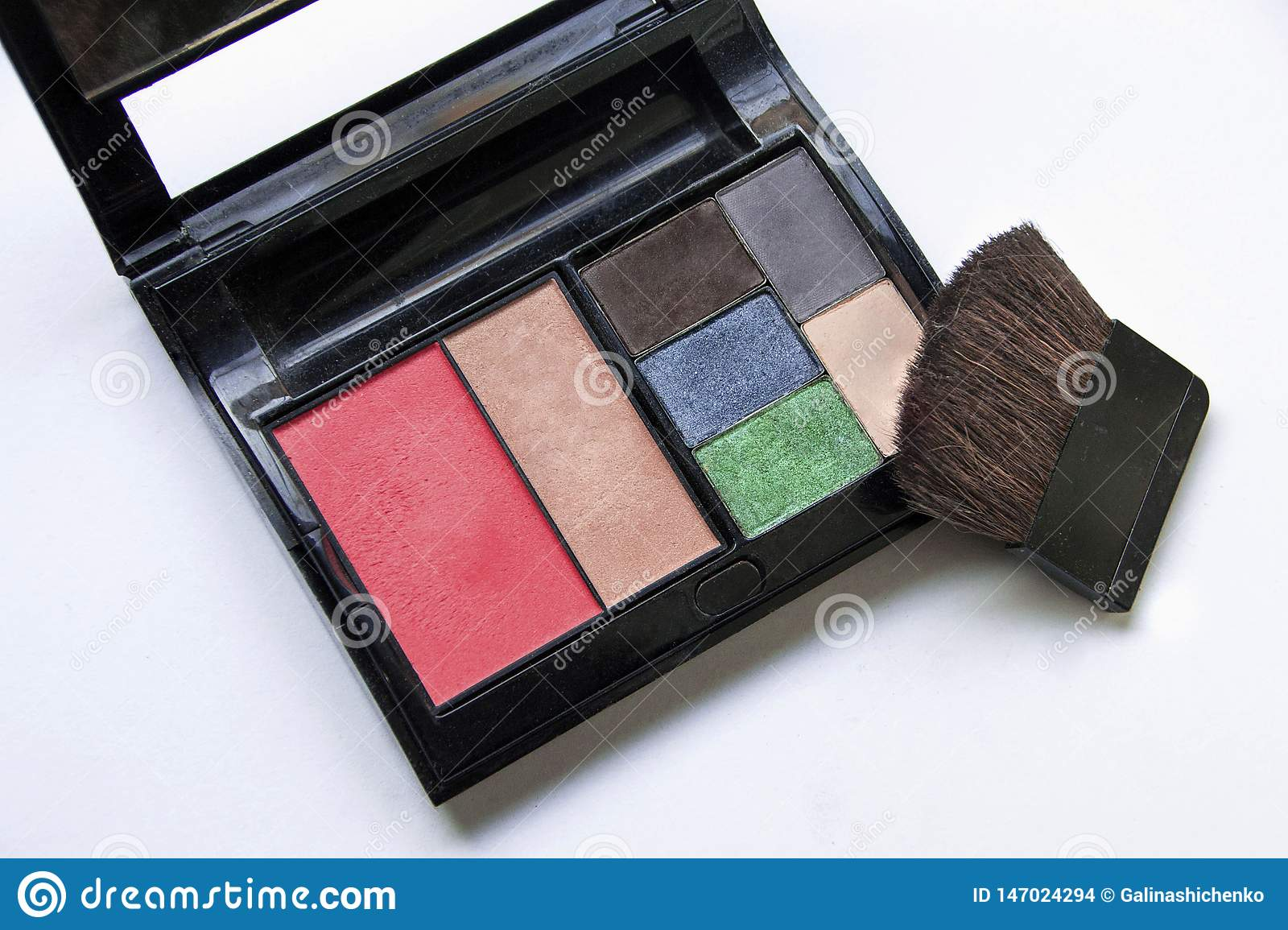 Eye-shadows and makeup brush and cosmetics, on a white background ,