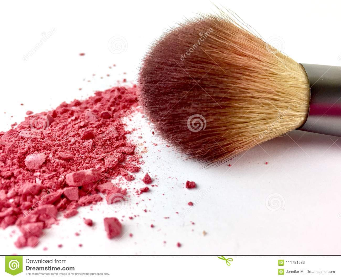 Makeup brush with pink blush powder on a white background