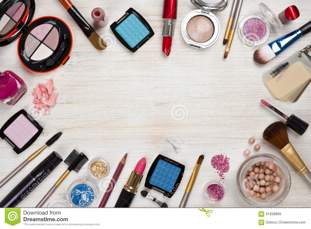 makeup products on wooden background with copy space in