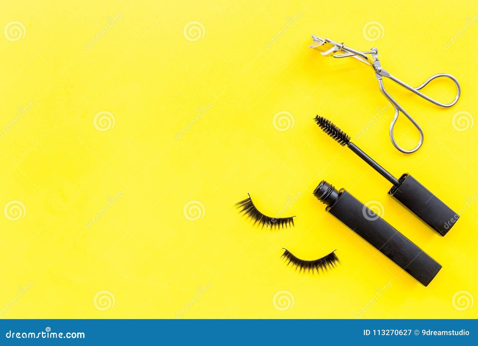 ea66f8f31c5 Makeup set for expressive eyelashes. Mascara, false eyelashes, eyelash  curler on yellow background