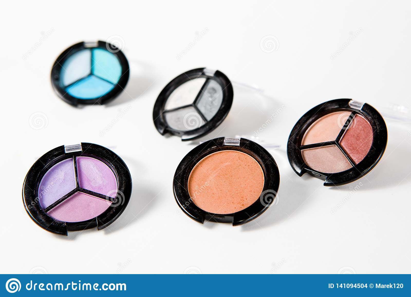 Makeup set in many shades on white background