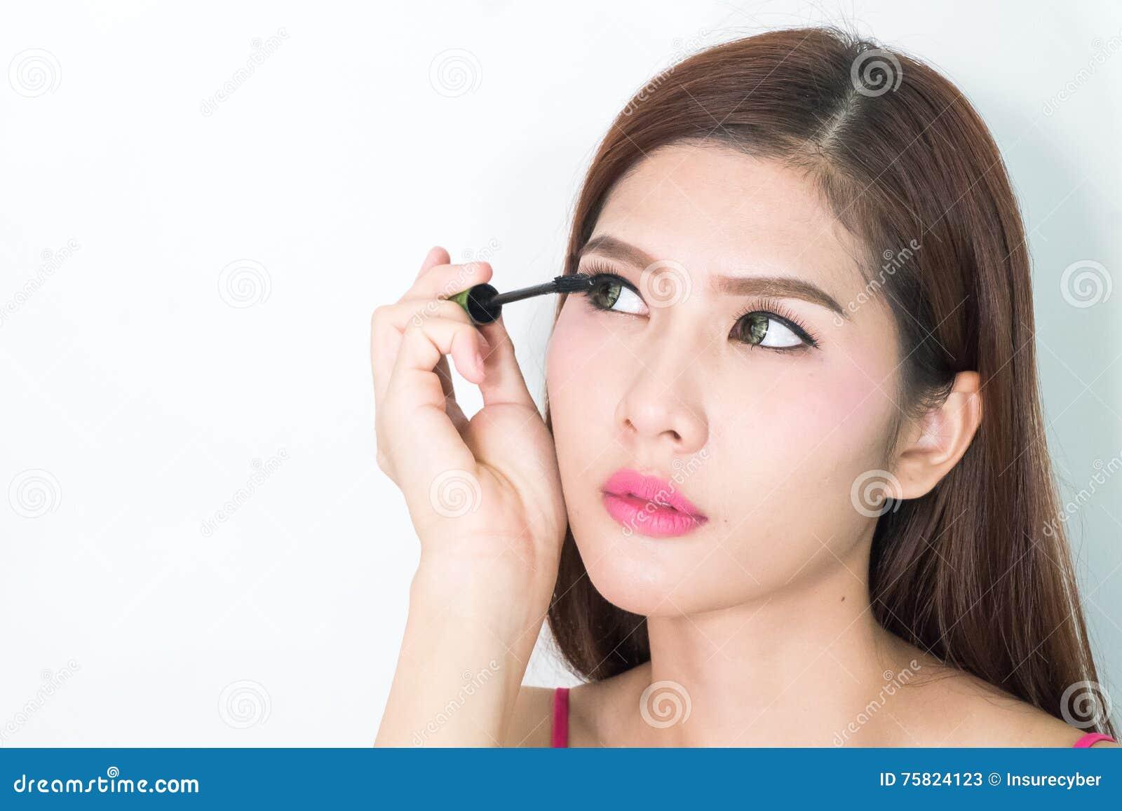 Putting on eye makeup