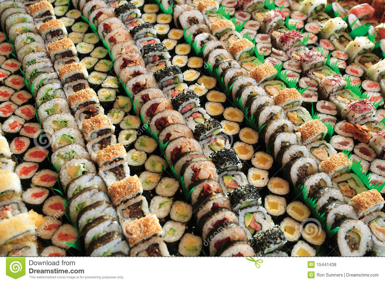 Photo of fresh maki sushi platter with a lot of variety. Selective ...