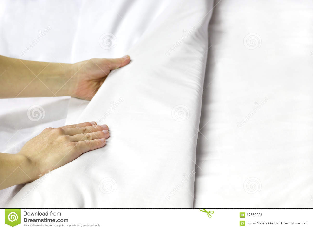 making a bed. stock photo - image: 67560288