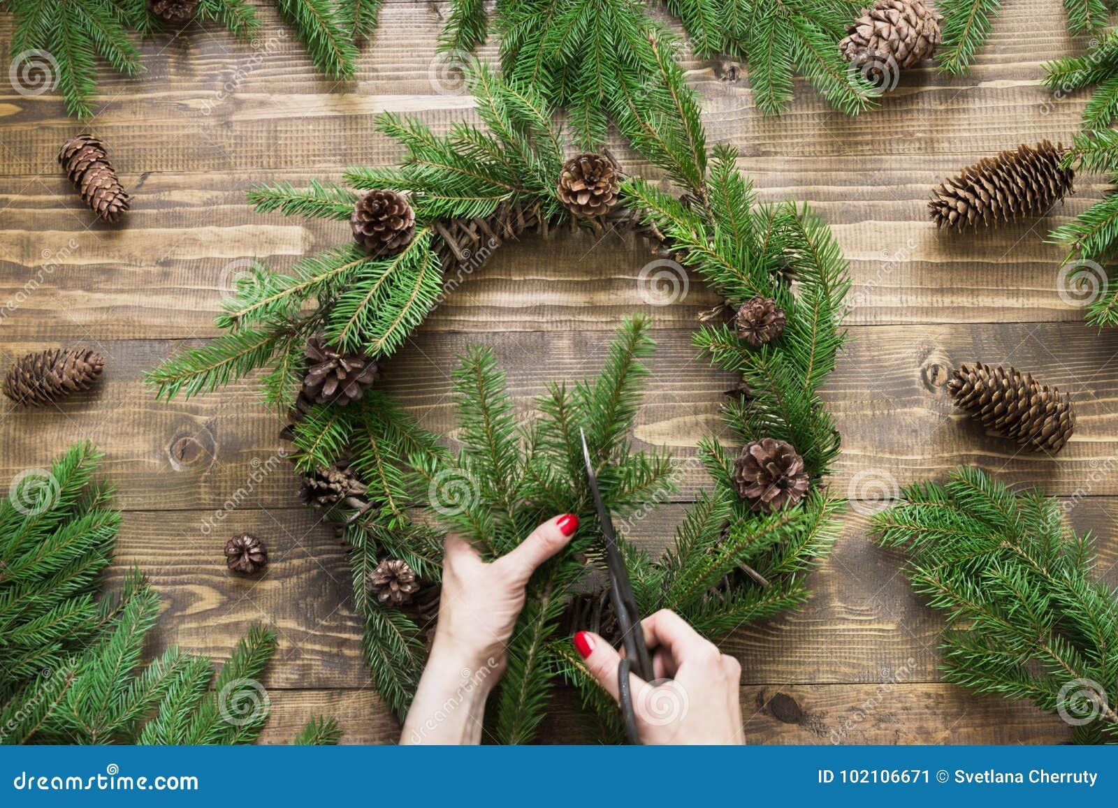 Making Christmas wreath using fresh and all natural materials.