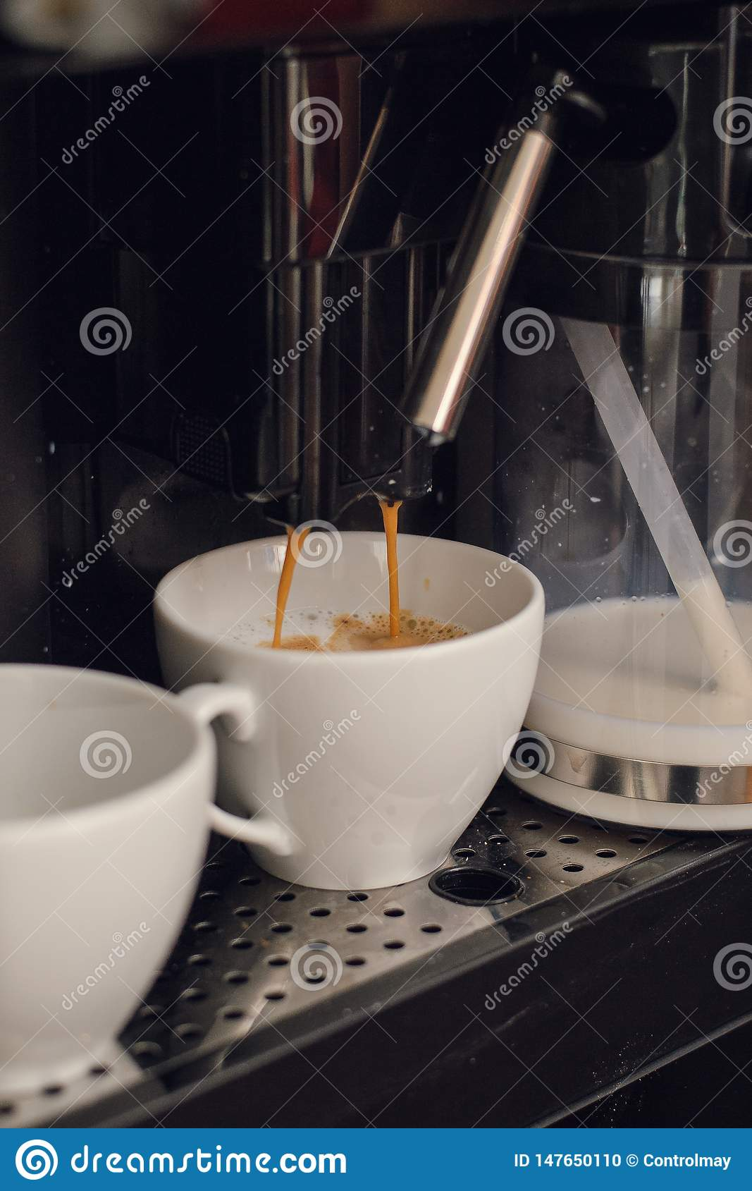 Making coffee in a coffee shop.