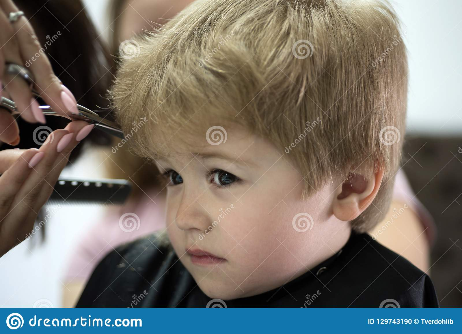 Making Haircut Fun. Little Child Given Haircut. Small Child In ...