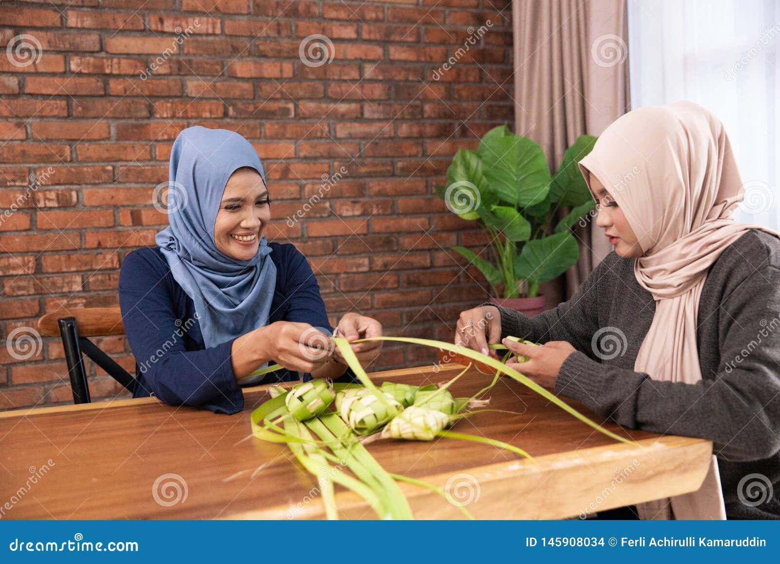 Making ketupat traditional indonesian food together