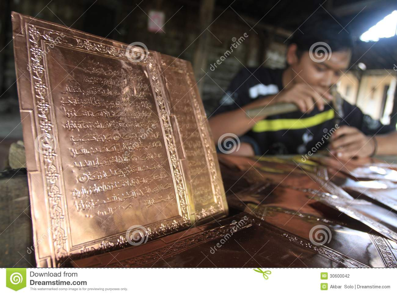 Boyolali Indonesia  city pictures gallery : Worker making koran Quran from Brass in Boyolali, Indonesia.