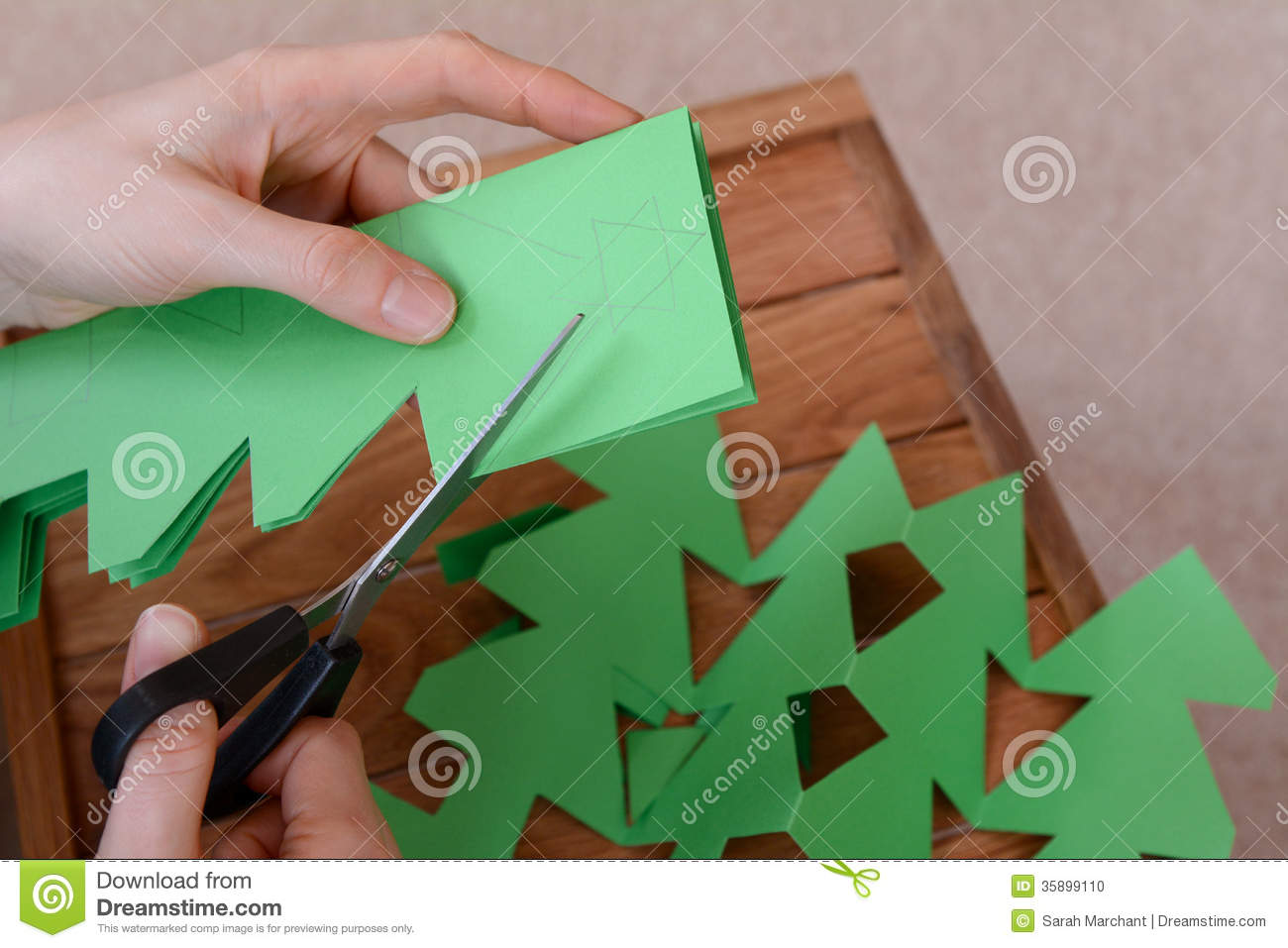 royalty free stock photo download making a paper chain of christmas trees - How To Make A Paper Christmas Tree