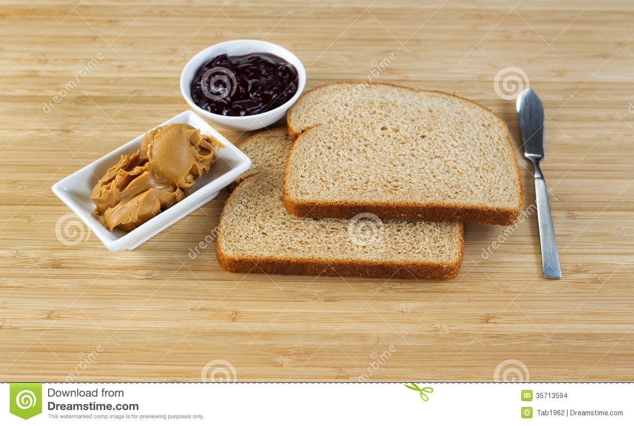 Horizontal photo of peanut butter and jelly sandwich ingredients and ...