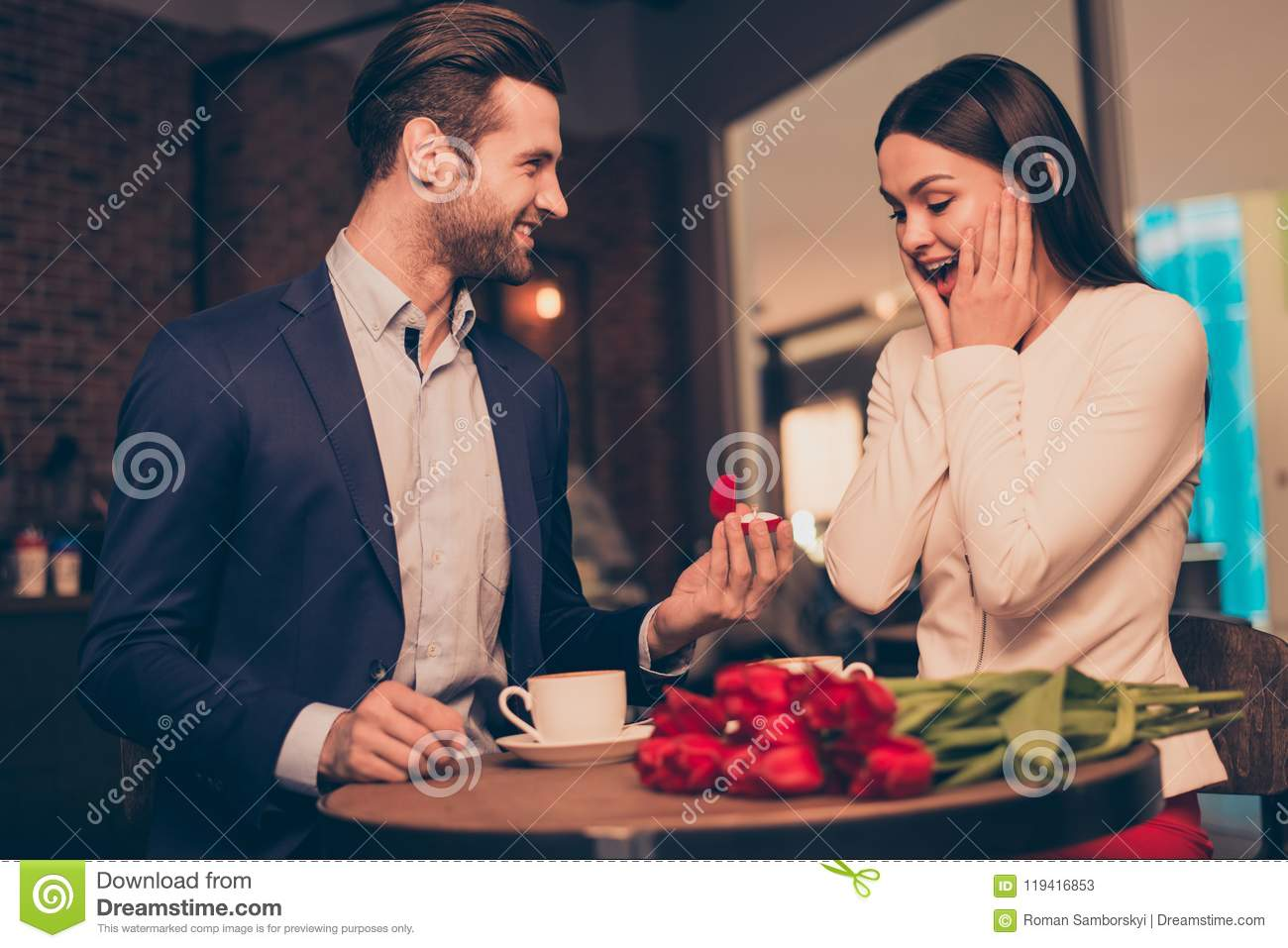 Making proposal in a cafe with ring and flowers unexpected moment honeymoon jewelry ring diamond golden concept wife husband