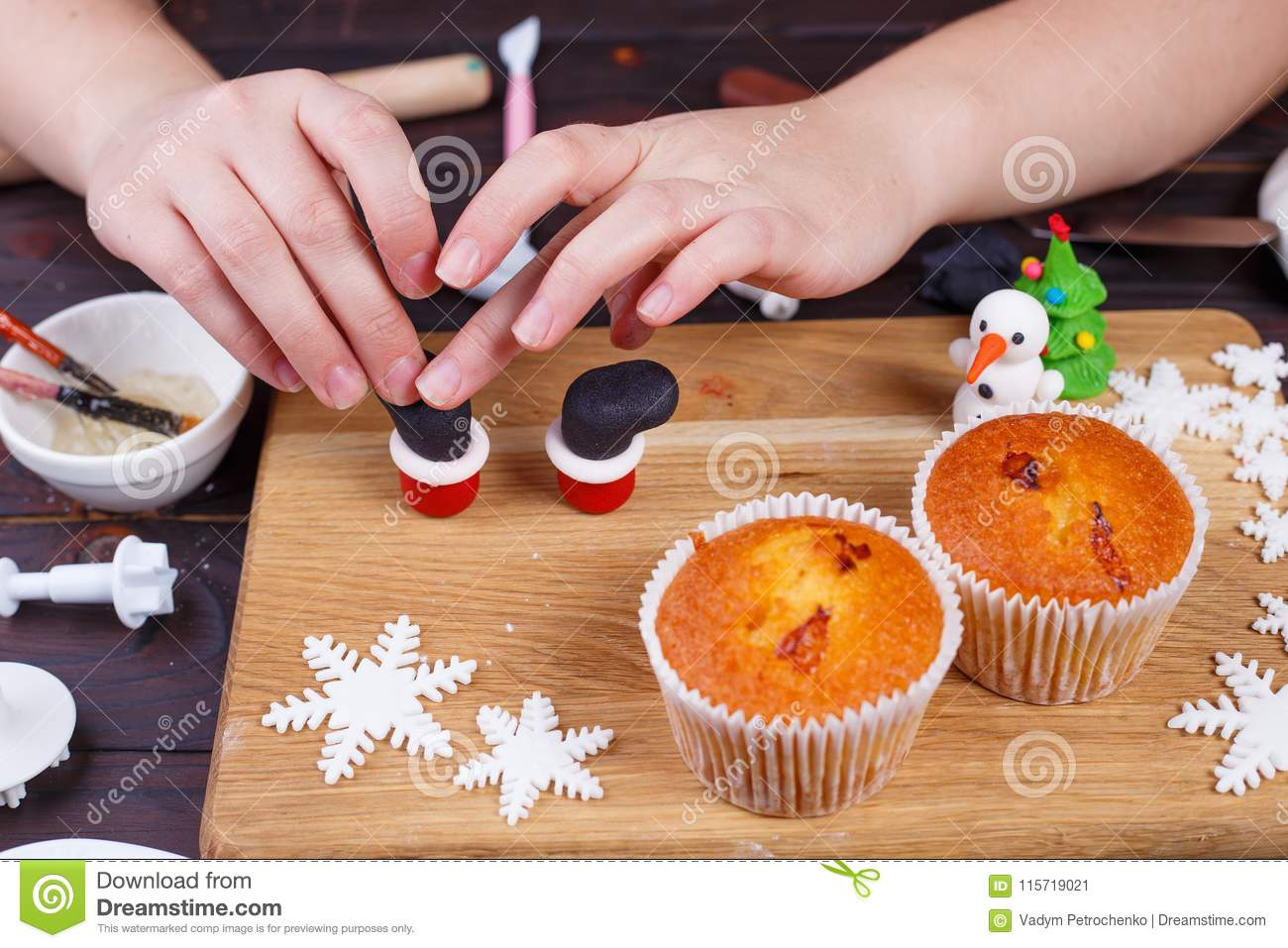 0567c9865fe6 Making Santa`s Boots Cupcake Decoration Of Confectionery Mastic ...