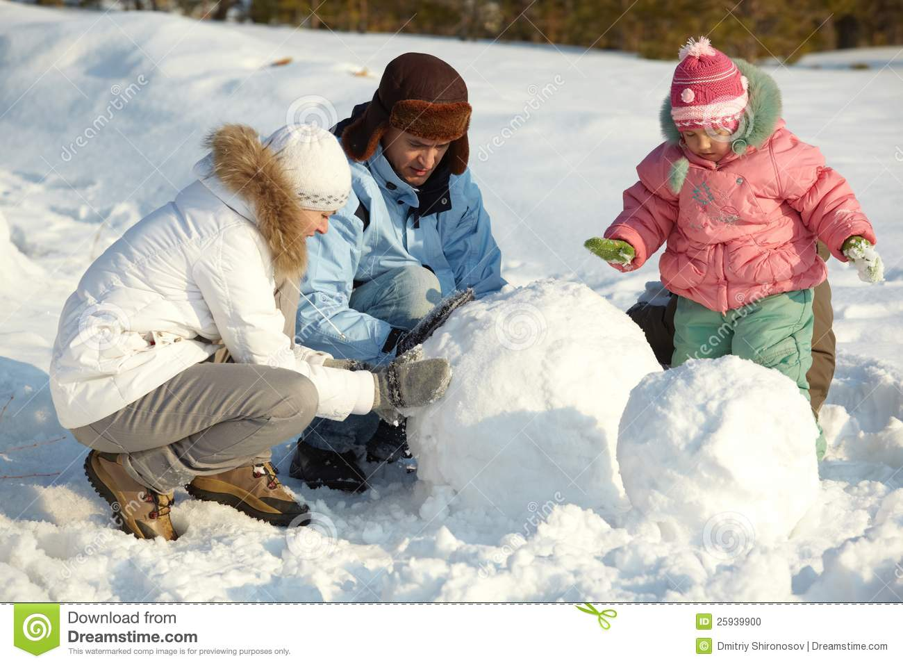 Making Snowman Stock Photo - Image: 25939900
