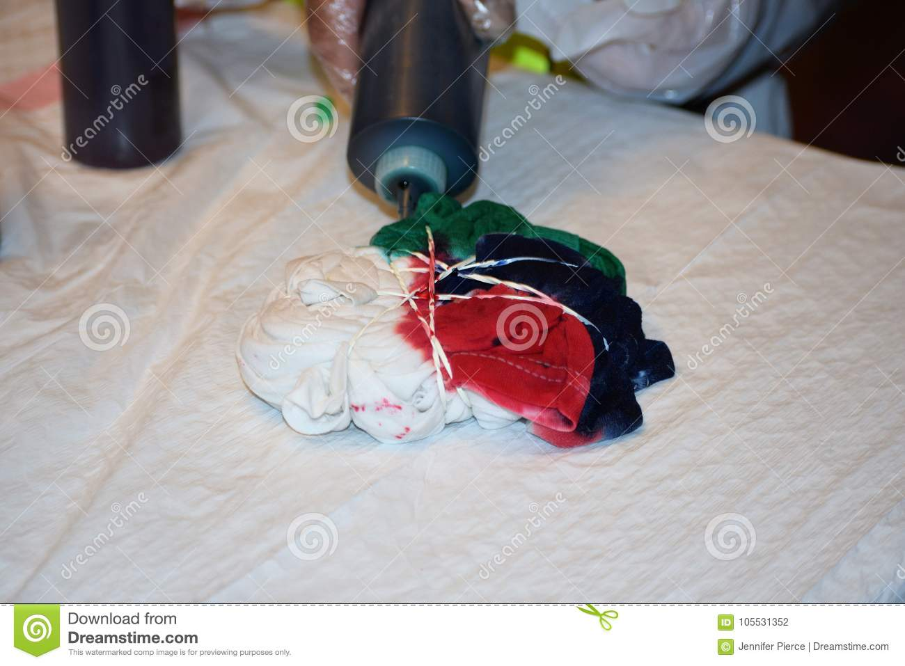 d75684c9 Making a tie-dye shirt stock photo. Image of dyed, dress - 105531352