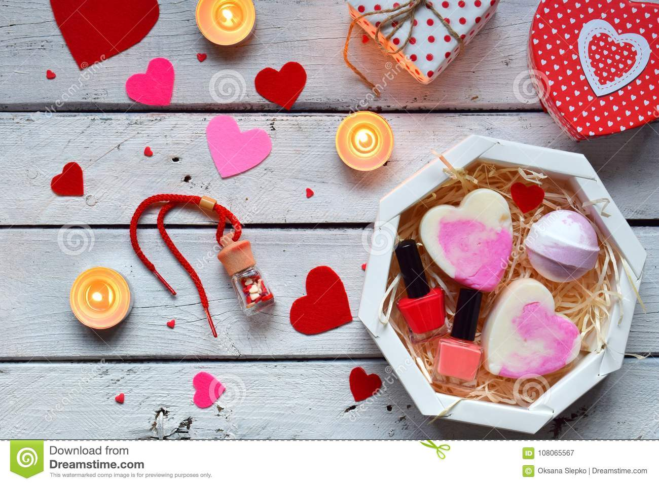 Making Valentine beauty gift. Various bath accessories. Items for the spa in pink color. Valentine`s Day background. Happy lovers