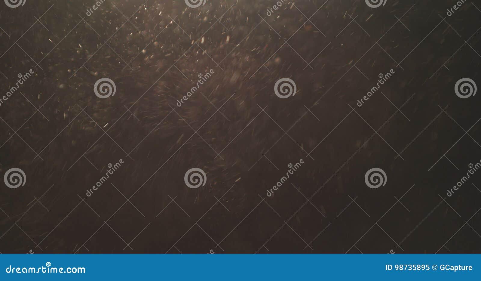 Makroskott av explosivt flöde för sanddamm för samkopiering