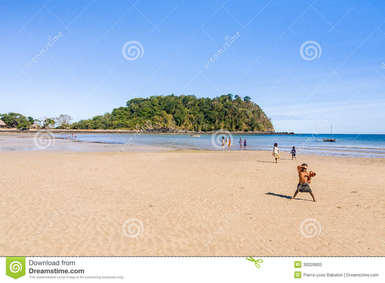 Malagasy children on the beach of Nosy Be island, north of Madagascar ...