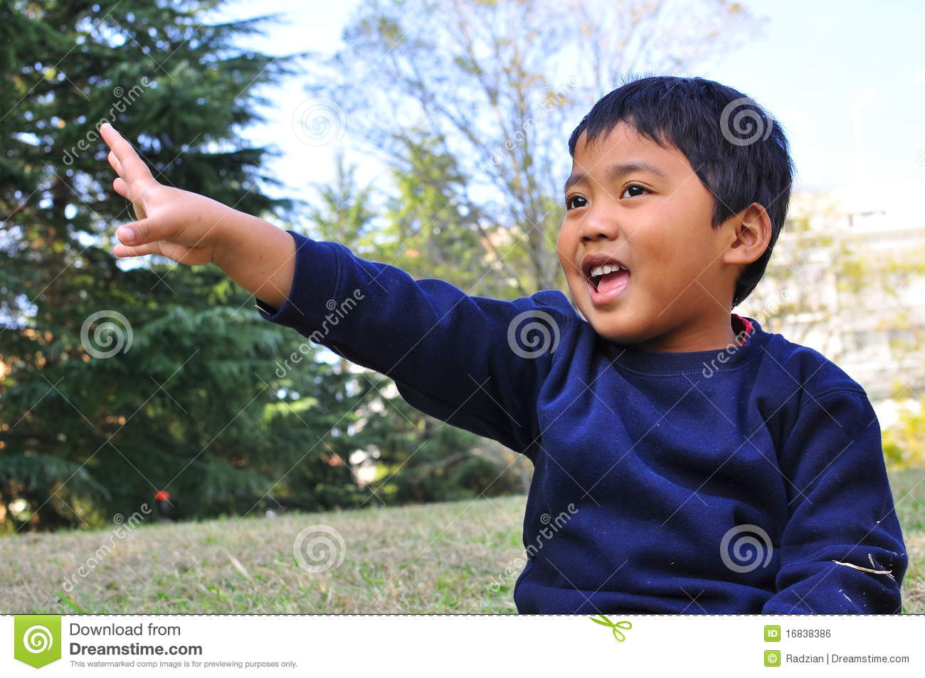 a malay child with a hand raised up royalty free stock image