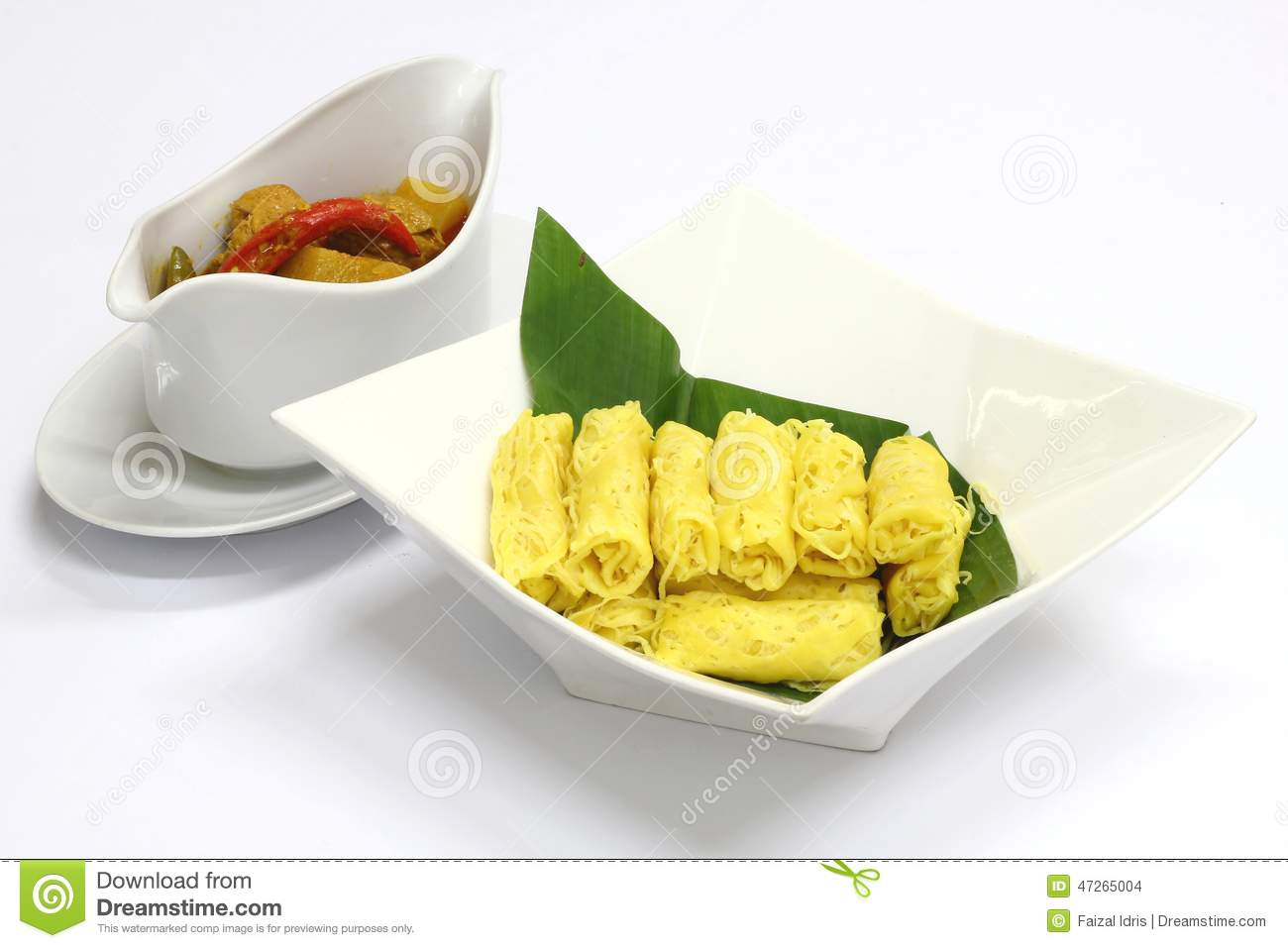 popular Malaysian savoury snack Roti Jala served with Chicken Curry.