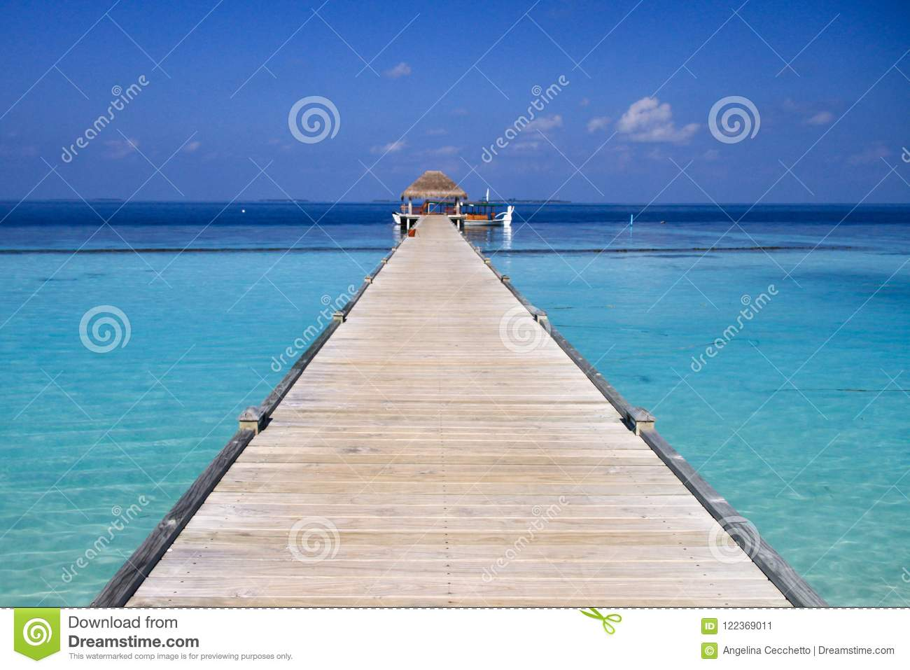 Maldives Island Resort Wood Pier and Turquoise Pacific Ocean Water.