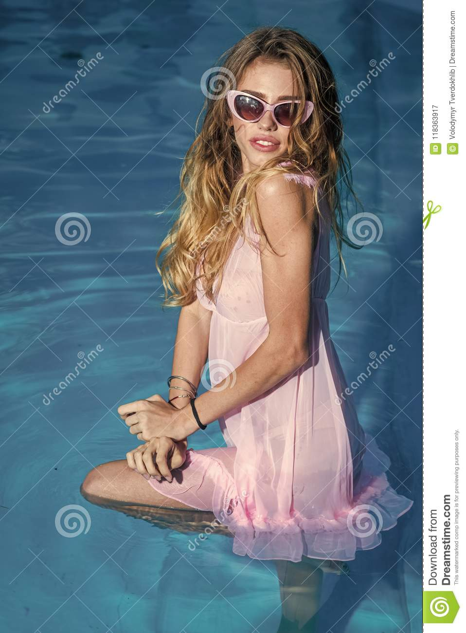 Maldives or Miami beach. Fashion and beauty of woman with natural makeup and hair.