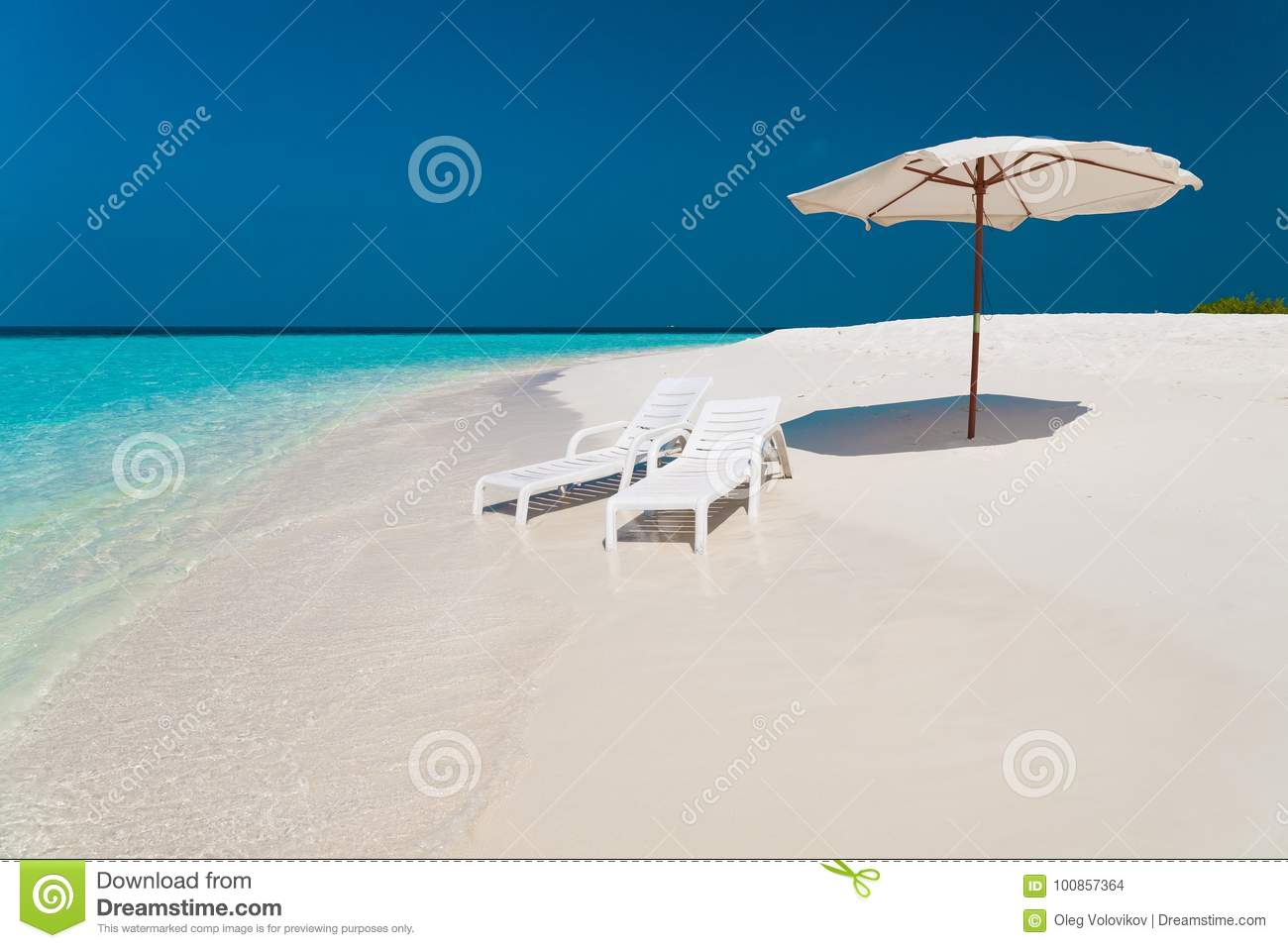 Maldives, white sunbed and parasol