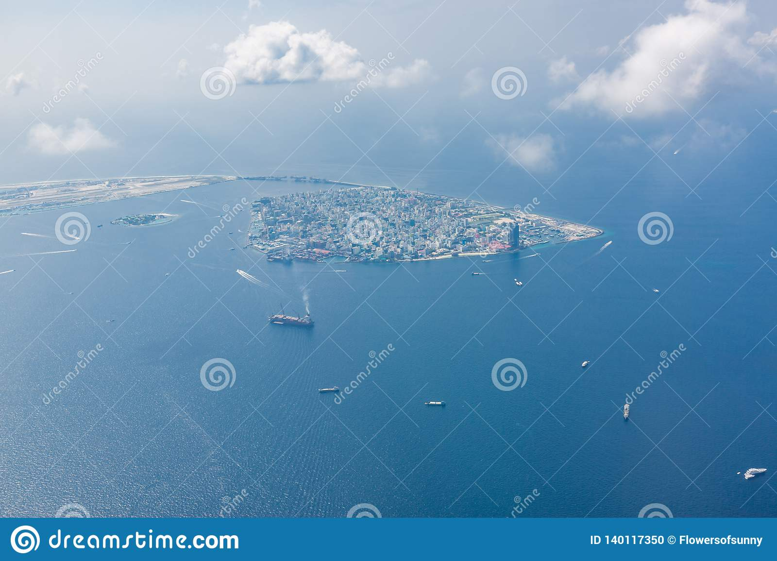 Maldivian Capital City Male From Above Blue Sea And Boats