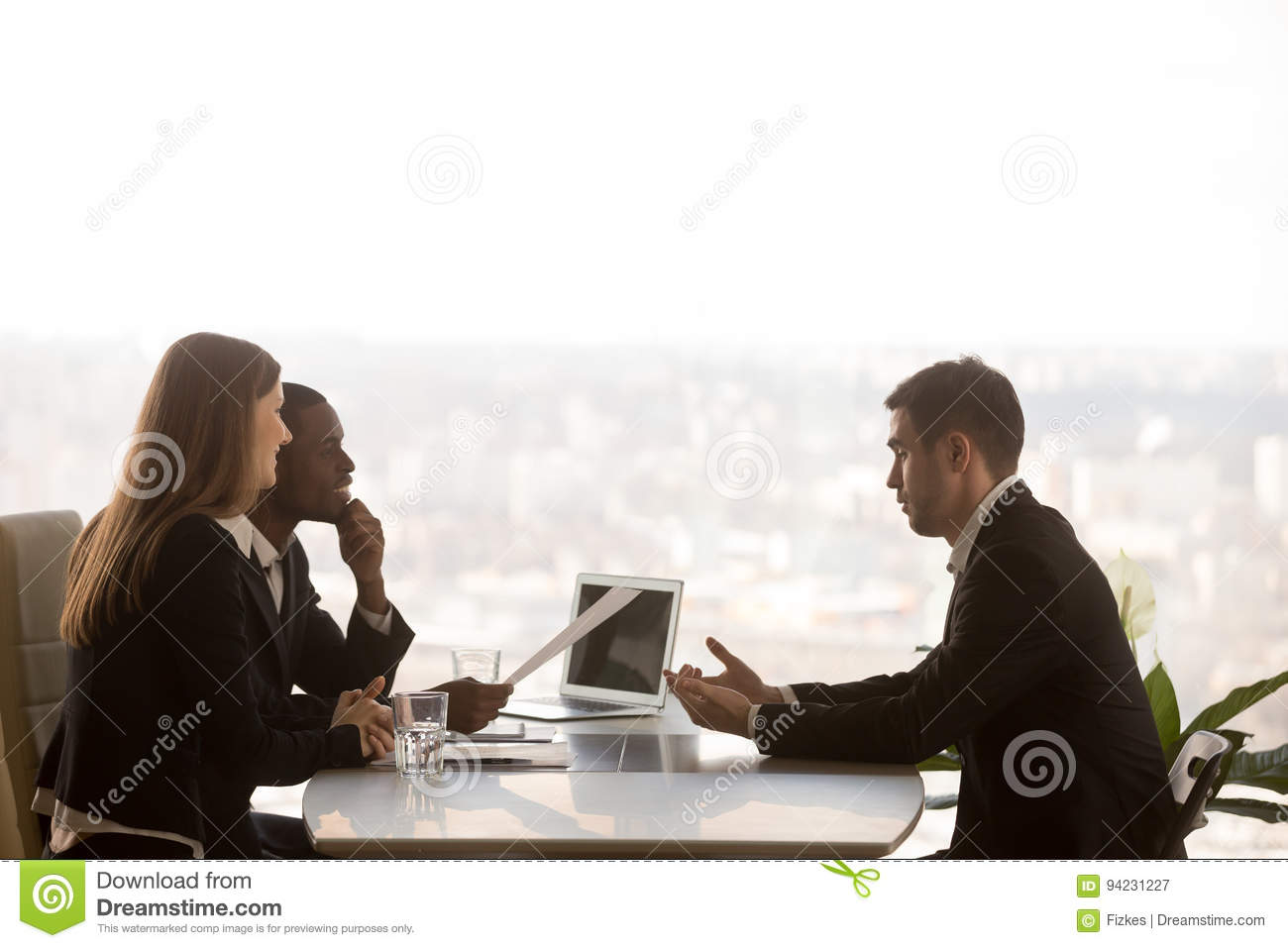 Male Applicant And Multi-ethnic Recruiters During Job Interview
