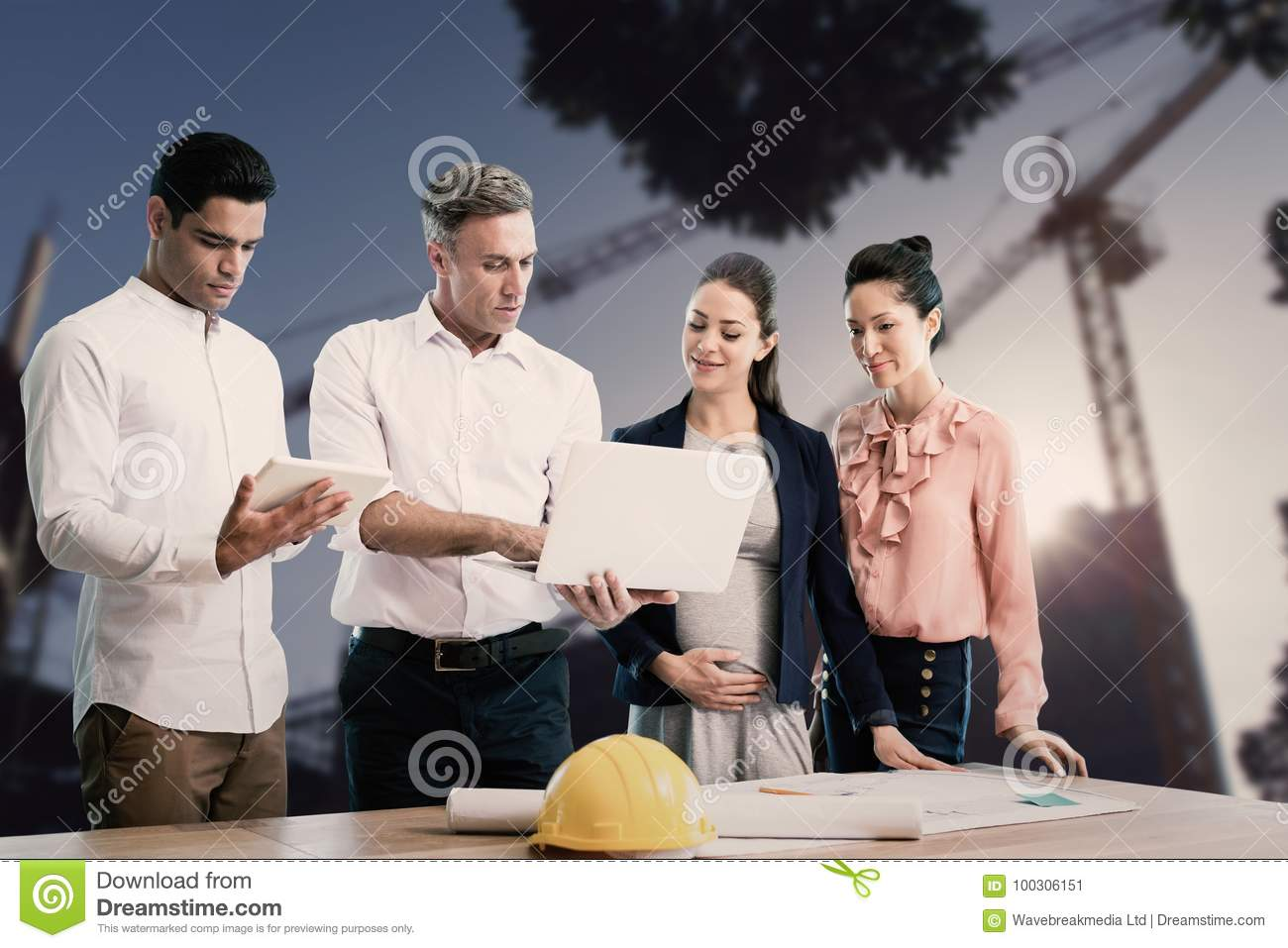 Composite image of male architect showing laptop to coworkers