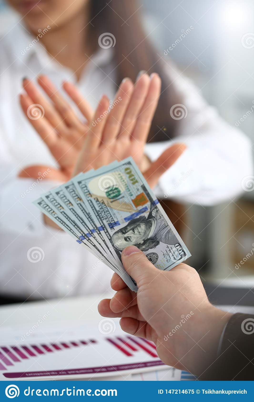 Male arm pay bunch of hundred dollars bills