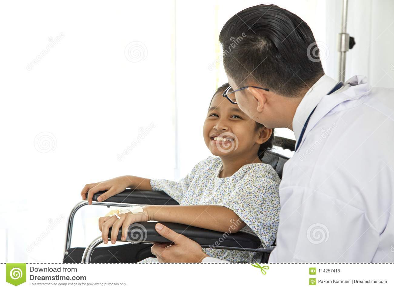 asian doctor touching pediatric patients