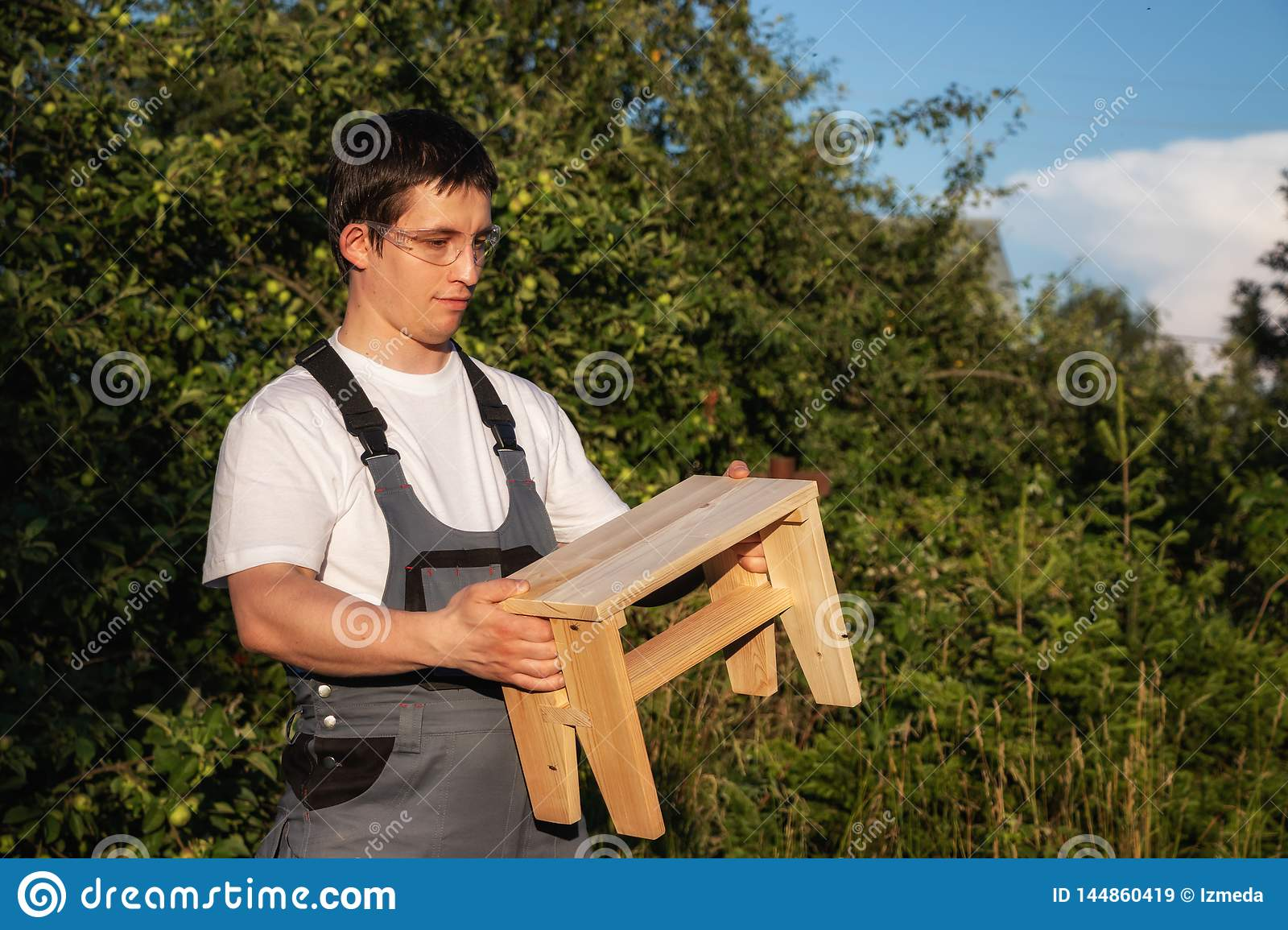 Surprising A Male Carpenter Is Holding A Wooden Stool Stock Image Ocoug Best Dining Table And Chair Ideas Images Ocougorg