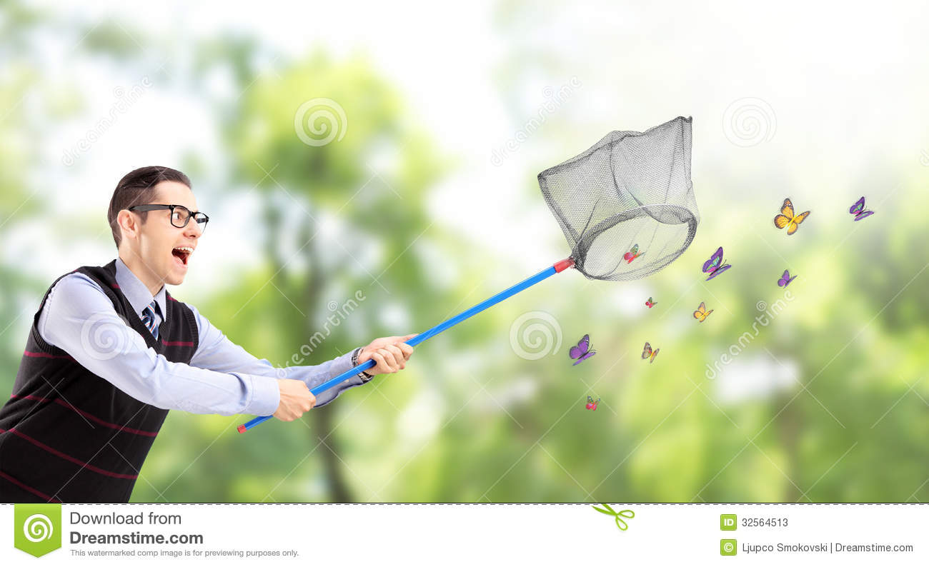 ... Catching Butterflies With Net In A Park Stock Photos - Image: 32564513
