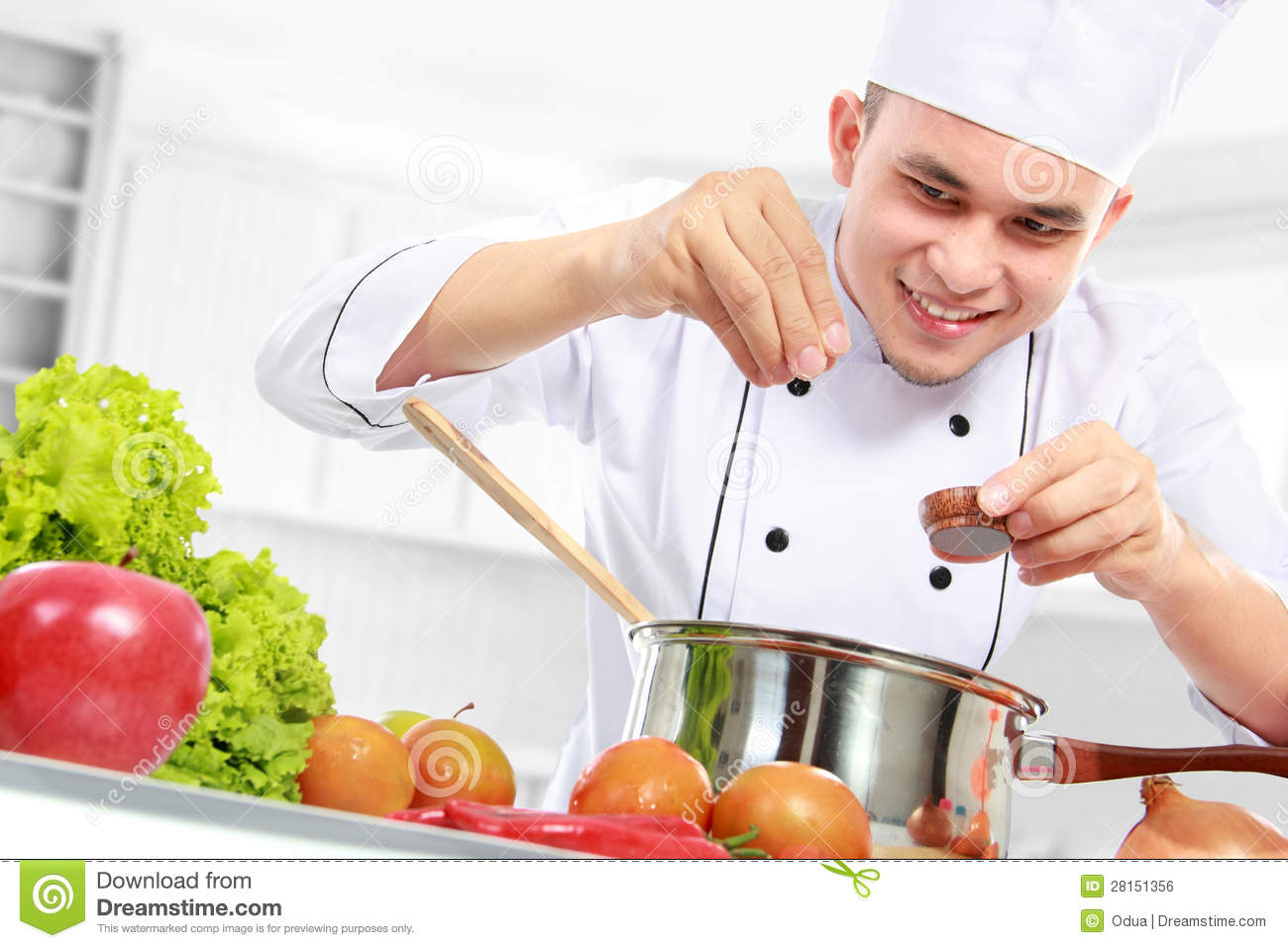 Male Chef Cooking Royalty Free Stock Image - Image: 28151356