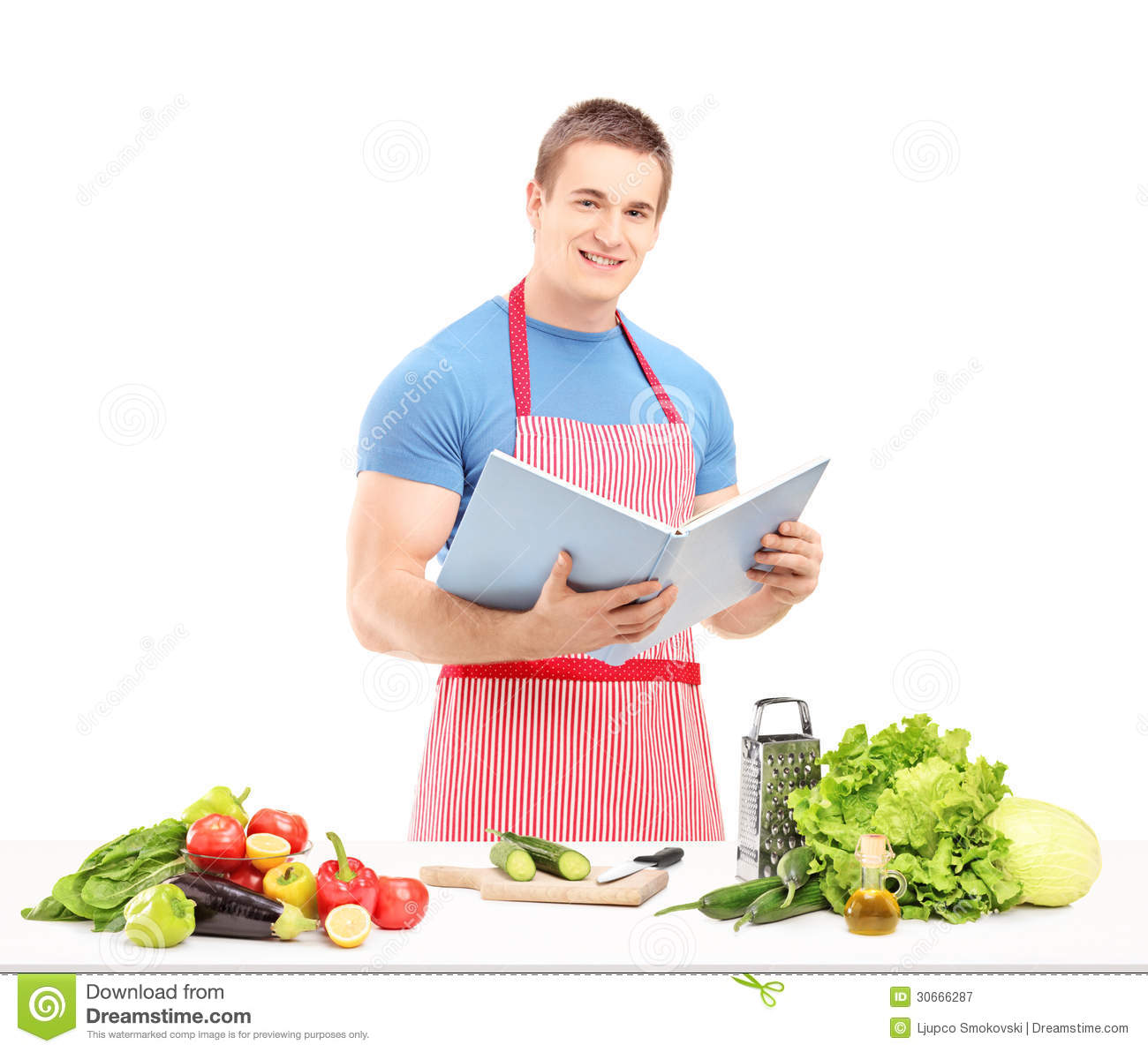 a male chef reading a cookbook while preparing a salad royalty free stock photography image. Black Bedroom Furniture Sets. Home Design Ideas