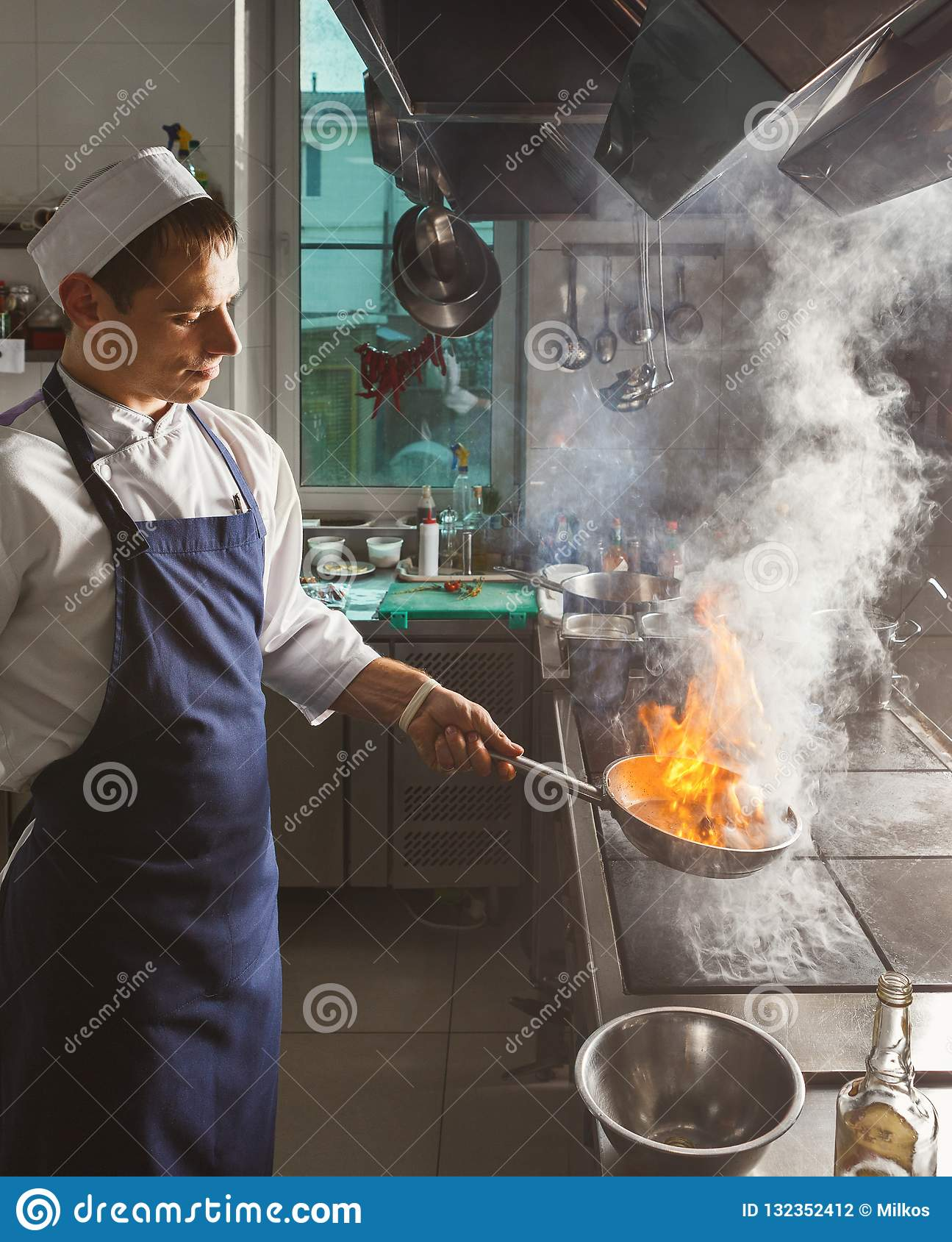 Chef Cooking Meat At Restaurant Or Hotel Kitchen Stock Photo Image Of Meal Apron 132352412