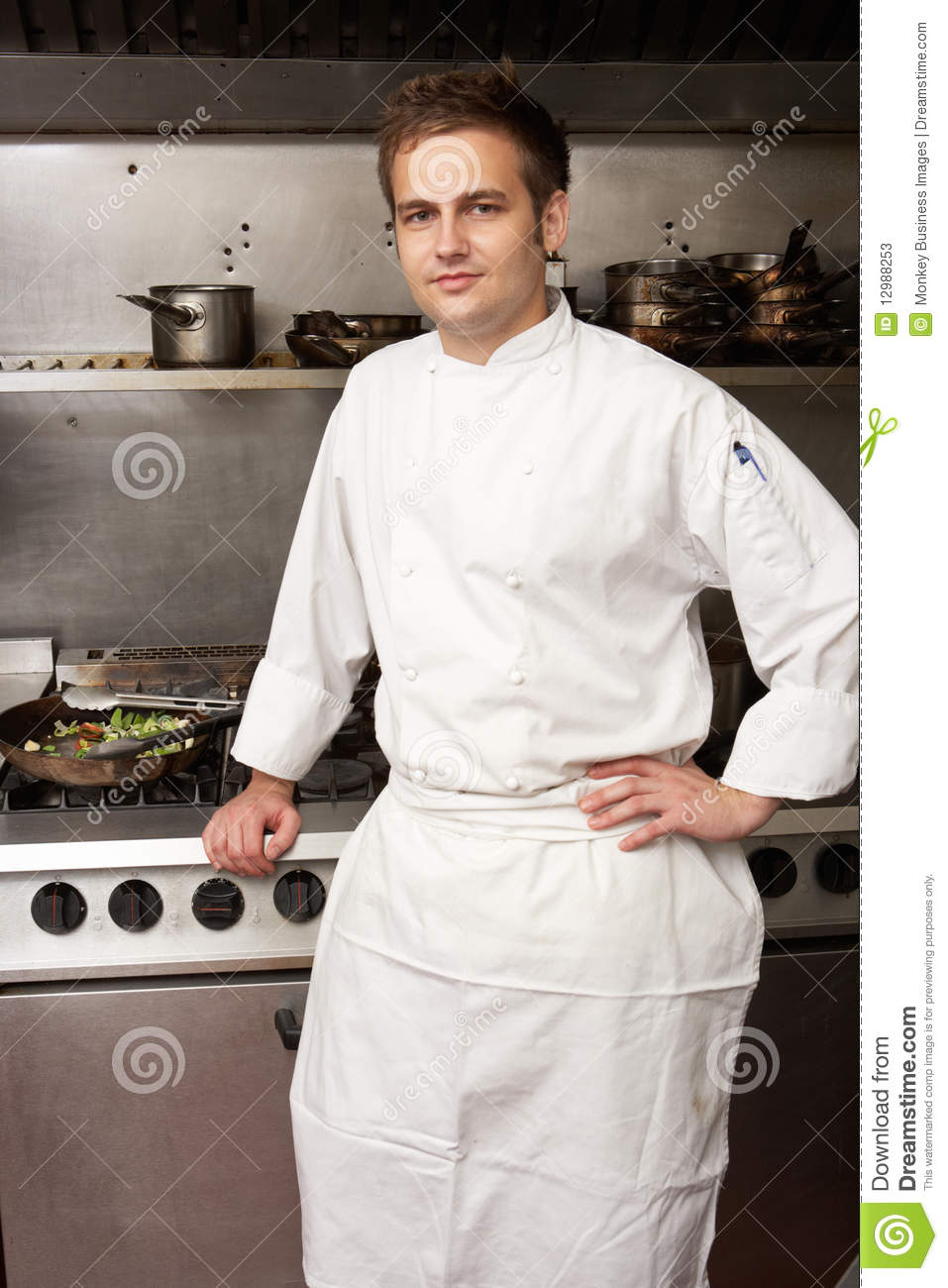 Male Chef Standing Next To Cooker