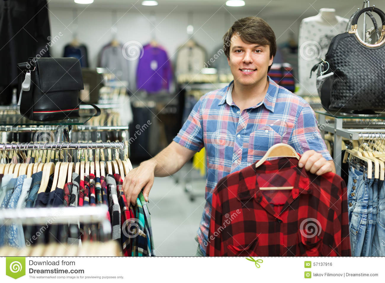 Male Choosing T-shirts In The Shop Royalty-Free Stock ...