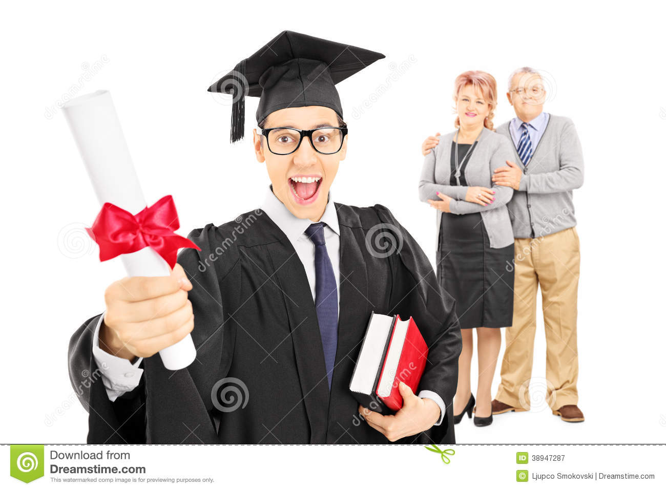 Male College Graduate And His Proud Parents Stock Photo