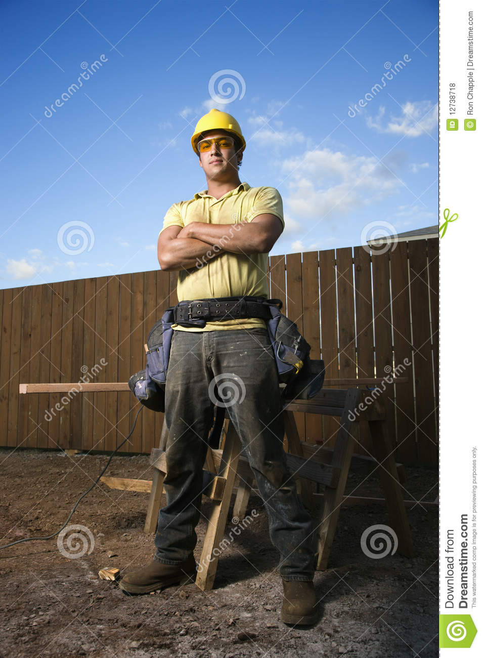 Male Construction Worker Stands With Folded Arms Stock